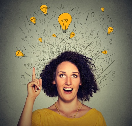 48488978 - closeup excited woman with many ideas light bulbs above head looking up pointing finger up isolated on gray wall background. eureka creativity concept